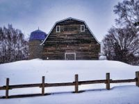 Backside of a dairy barn in the snow