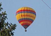 Hot air balloon passing over backyard