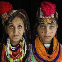 Abi Gul and her Grandmother Bibi Kai of the polytheistic Kalash Tribe, Chitral village of Rumbur, PK