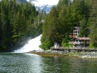 Alaska Cabins, boardwalk, and waterfall at Warms Springs Bay