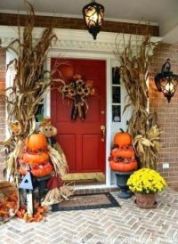 Autumn porch decor with red door