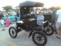 My young Wife with an Early 1900 Oldsmobile