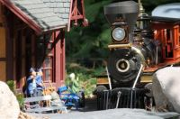 model train picks up passengers