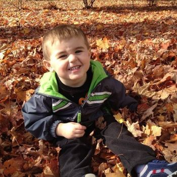 grandson helping the leaves dry after Hurr. Sandy