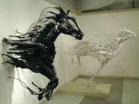 Amazing art two piece installation made from reclaimed plastic utensils by Sayaka Ganz