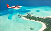 flying over Maldives beaches