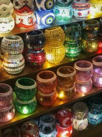 assorted-mosaic-glass-candle-holders-on-shelf-2386148