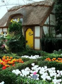 thatched cottage and spring garden
