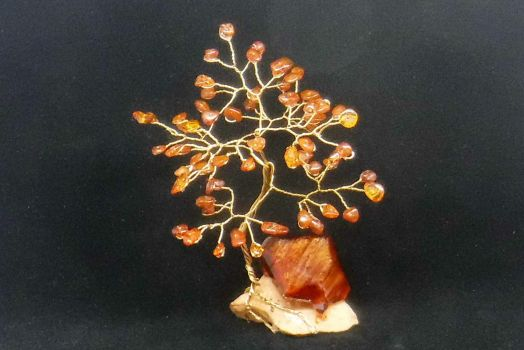 Amber gem tree on a crystal base