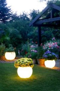 Lit pots in backyard
