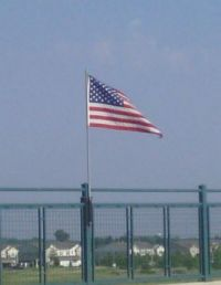 old glory on a freeway overpass