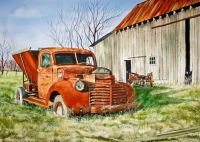 barn and rusted truck