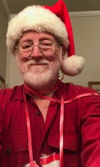 Most Santa-like person in the house
