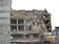 Apartment building being demolished