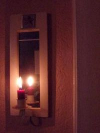 The candle and the mirror
