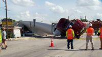 Train slamming into semi-truck hauling wind turbine blade in Luling