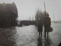 After the flood in 1953, my father and mother before our house