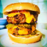 Double Cheeseburger with pickle, raw onion, tomato, ketchup and mustard