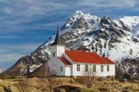 Sildpollnes_Church__Austvågøya Island,_Norway,_Mountain Higravstindan is the islands tallest mt.