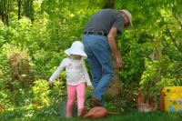 Helping Grampa in the flower garden