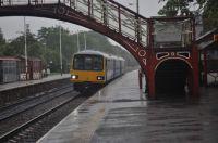 144016 at a very damp Garforth station 27-7-19