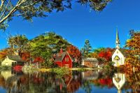 Autumn village by the river