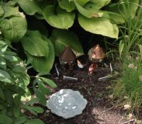 Wee garden gnomes and their homes.
