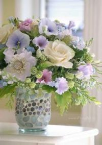 Happiness is.... A  Jewel Encrusted Vase with perfectly matched Pastel Flowers.