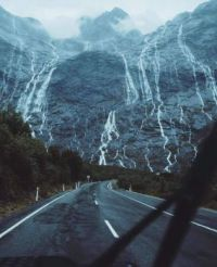 Driving through Fiordland National Park, New Zealand.