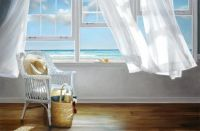 chair by window with ocean view