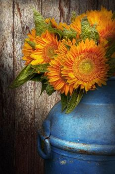 Fall flowers in an old milk can