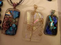 THEME:  Jewelry  Some gold wrapped, fusible glass necklace pendants I made.  (Larger) Ask if you want more pieces.