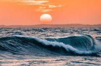 Orange sunset above the waves