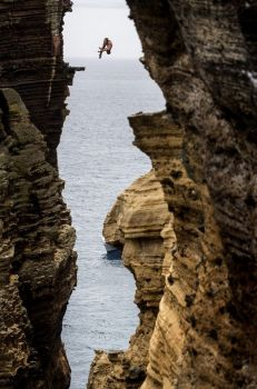 diving from rock monolith at red bull in Portugal