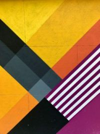 Red, yellow, black, and white textile photo by Malena Gonzalez Serena