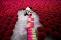 a woman collects incense sticks