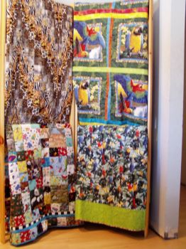quilts on quilt rack