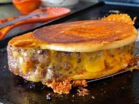 Meatloaf sandwich griddle fried with sharp cheddar on a bagel thin