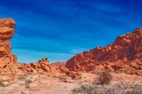 Bright red Aztec sandstone outcrops nestled in gray and tan limestone, Valley of Fire State Park, Nevada