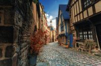 Cobblestone street with medieval half-timbered houses in Dinan, Bretagne, France